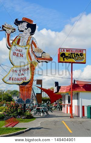 GRANBY QUEBEC CANADA 09 28 2016: Sign of Cantine Ben La Bedaine fast food restaurant some of the best Quebecois comfort food available.
