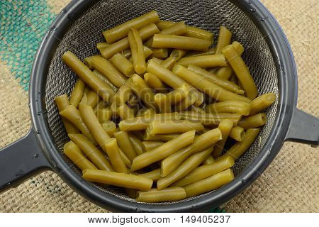 Close up of rinsed canned green beans in strainer
