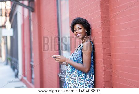Portrait of young African American woman listening to music. Photographed in Soho NYC.