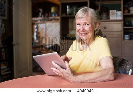 Happy Woman Using Tablet Computer