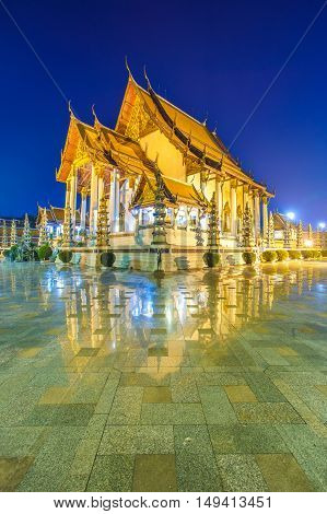 Wat Suthat Thepphawararam with blue sky at twilight time background in Bangkok of Thailand