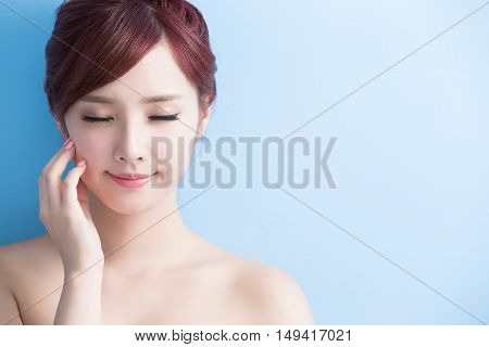 beauty skin care woman relax closed eyes isolated on blue background asian