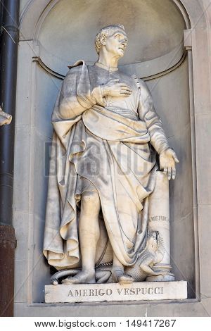 FLORENCE, ITALY - January 20, 2016: Amerigo Vespucci ( italian florentine explorer, financier, navigator and cartographer ) statue by Gaetano Grazzini on facade of Uffizi Gallery, Florence, Italy