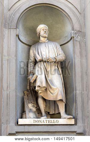 FLORENCE, ITALY - January 20, 2016: Donatello ( italian sculptor ) statue by Girolamo Torrini and Giovanni Bastianini on facade of Uffizi Gallery, Florence, Italy