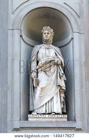 FLORENCE, ITALY - January 20, 2016: Giovanni Boccaccio ( italian florentine poet and writer ) statue on facade of Uffizi Gallery, Florence, Italy