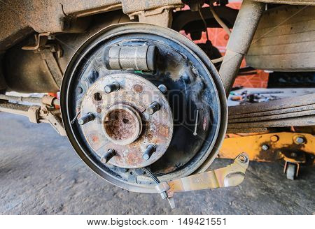 Disc brake on car in process of new tire replacementCar brake repairing in garage