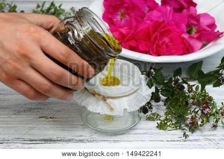 Alternative medicine remedy oil from curative herbs perfect for skin with essential oil from scented flowers