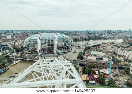 LONDON UK - AUGUST 23 2015: London Eye´s structural detail in a cloudy morning. The London Eye is giant Ferris wheel on the South Bank of the River Thames in London. Also known as the Millennium Wheel.