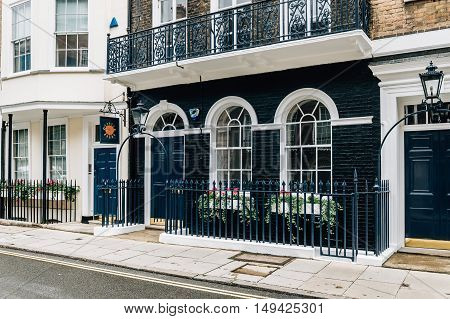 LONDON UK - AUGUST 24 2015: Elegant apartment house in London's luxury neighborhood: Pall Mall and St. James street