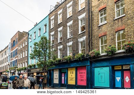 LONDON UK - AUGUST 24 2015: View of Carnaby Street. Carnaby Street is a pedestrianised shopping street in Soho in the City of Westminster London