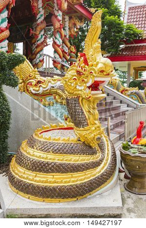 gold beautiful serpent or Naka in temple