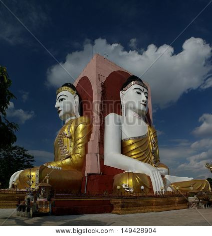 View of Kyaikpun pagoda four Buddha images Bago Myanmar
