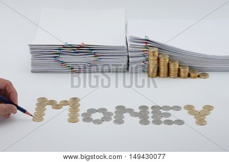 Pencil In Man's Hand With Sort Coins As Money
