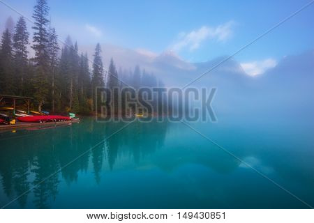 Emerald Lake in Yoho National Park. Travel to Canada. Foggy morning