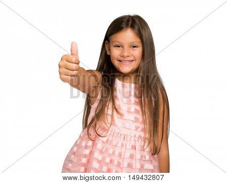 Little smiling girl making ok sign isolated