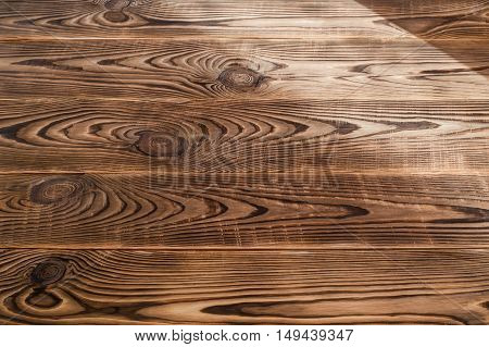 Brown aged natural wood texture with light spill on it