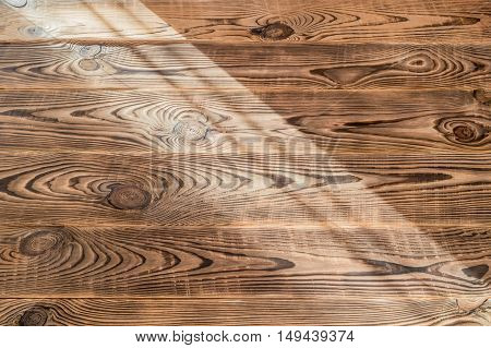 Brown aged natural wood texture White aged natural wood texture with light spill on it
