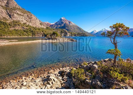 Beauty lake and mountains landscape in Nahuel Huapi National Park located near Bariloche Patagonia region in Argentina. poster