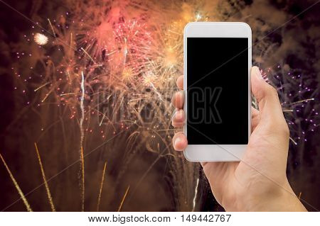 Shot of fireworks with the smartphone in new year
