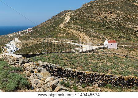 White church and panorama to Mykonos island, Cyclades, Greece