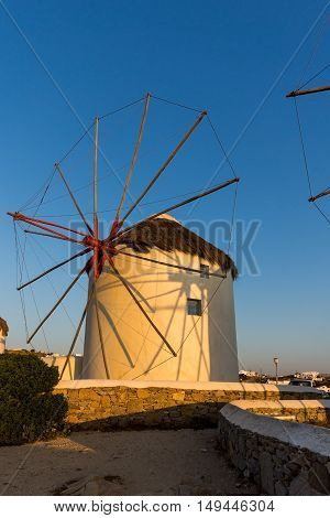 Sunset over White windmills on the island of Mykonos, Cyclades, Greece