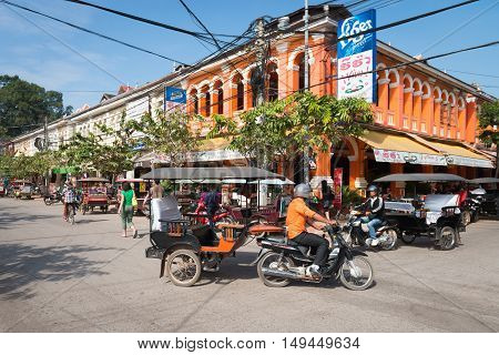 Tuk-tuk Tourist Taxi On The Central Street Of The Old Siem Reap Town