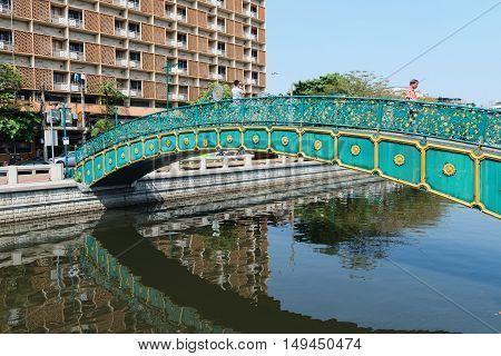 Pedestrian Bridge Over A Bangkok Canal On A Sunny Day.