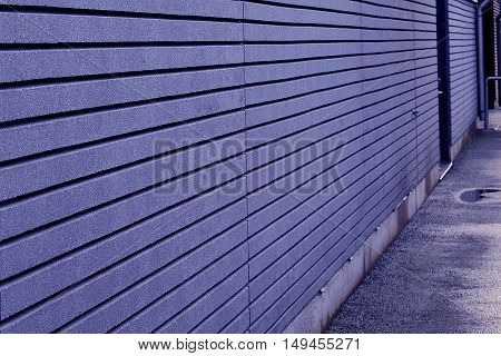 Grey / blue outer wall close up.