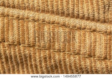 closeup seam on yellow material of corduroy pants