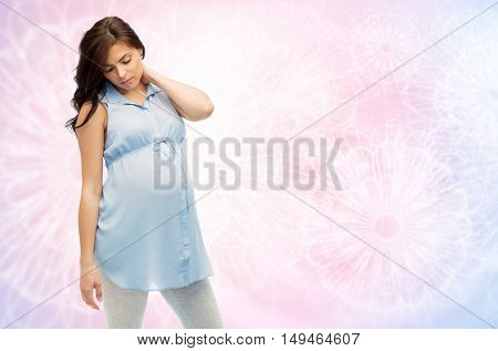 pregnancy, health, people and expectation concept - pregnant woman in bed touching her back and suffering from neckache over rose quartz and serenity pattern background