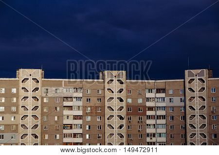 Dormitory area building just before the storm comes at sunset. Copy space text.