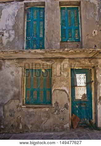 the old building with shutters on the Windows on the street Rethymno Crete
