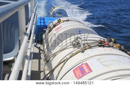SAINT-TROPEZ FRANCE - AUGUST 21 2016: Life raft cannisters and other safety equipment on a passenger ferry across the Mediterranean