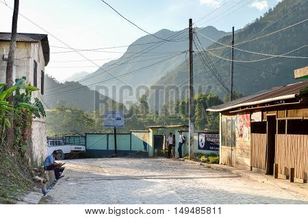 Lanquin Guatemala - February 22 2015: The small town of Lanquin is lit by sunlight with the mountains of Alta Verapaz region seen on the background Guatemala