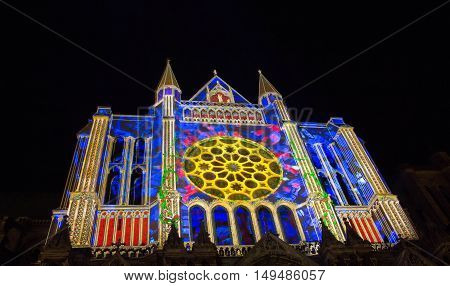 The Our Lady of Chartres cathedral illuminated during Chartres Light show. Colorful light illumine historic places and some principal buildings throughout the event.