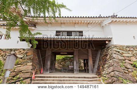 WAKAYAMA JAPAN - JULY 24 2016: Ninomon (or Kusunoki) Gate of Wakayama castle Japan. Castle was erected in 1585 bombed out in 1945 reconstructed in 1958