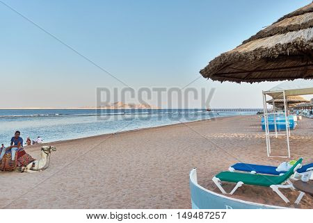 SHARM EL SHEIK, EGYPT - AUGUST 25, 2015: The beach is nearly empty at late afternoon