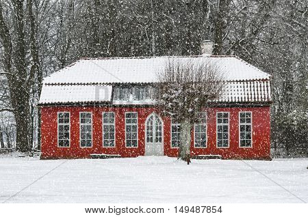 View of a snow covered Hovdala Castle Orangery in Hassleholm region. Hovdala Castle is a castle in Hassleholm Municipality Scania in southern Sweden.