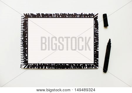 Opened empty notebook page banner with black marker painted abstract frame isolated on white desk table background Copyspace for text Planning concept idea simple action plan