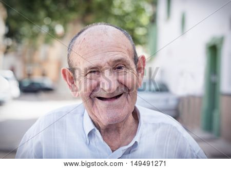 Happy smiling 78 year old elder senior man portrait