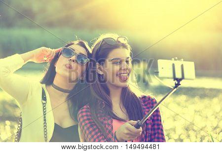 Two Girls Taking Selfie