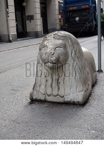 iconic lion statue on main shopping street Drottninggatan in Stockholm Sweden Europe