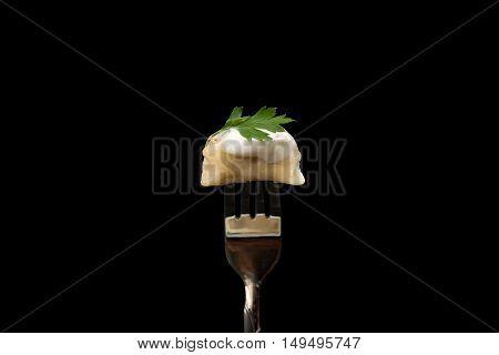 Pelmeni - Russian cuisine meat dumplings single on fork