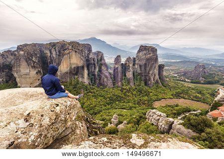 Man Looking At Meteora Phenomenon