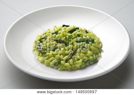Dish of risotto with asparagus isolated on white plane