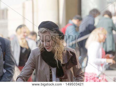 STOCKHOLM - SEPT 24 2016: Beautiful blonde woman dressed in old fashioned tweed clothes in the Bike in Tweed event September 24 2016 in Stockholm Sweden