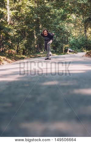 Longboard Skating - Skateboarder Ride A Longboard Through The Forest