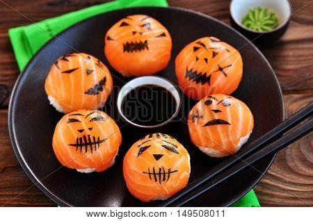 Halloween party sushi, Temari sushi, sushi balls on wooden background.