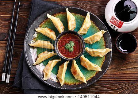 Fried asian dumpling wonton with chili sauce