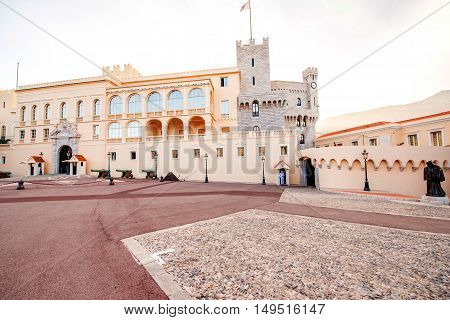 Monte Carlo, Monaco - June 13, 2016: Princely Palace of Monaco with guard on the sunset. Guards unit was created in 1817 to provide security for the Palace, Sovereign Prince and his family.